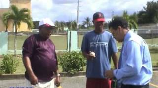 Cesar Presbott gives baseball tips to teen in San Padre De Marcaris DR