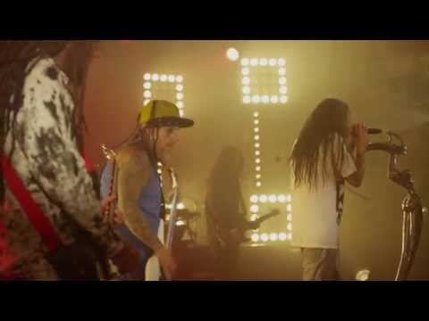 center - An exclusive clip of Korn performing