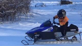 5. Four-year-old riding snowmobile Yamaha 120 SRX