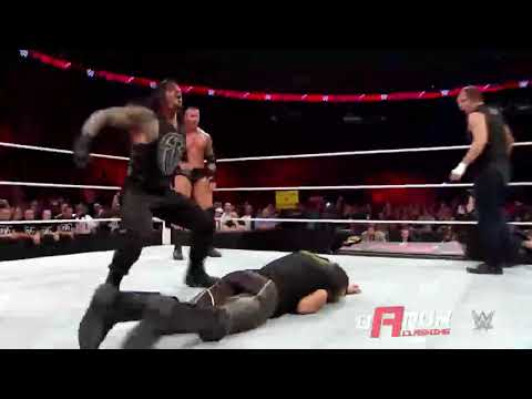 Roman Reigns Spears to Seth Rollins