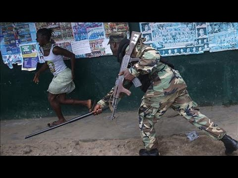 IN - Liberian soldiers fired into a crowd of young men who were trying to escape a quarantined ebola-stricken neighborhood. Wednesday's clashes reflect an emerging security crisis days after residents...