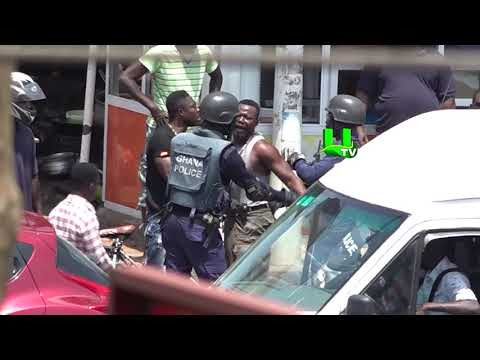 Video shows man resisting arrest from the police at Abeka Junction, Accra