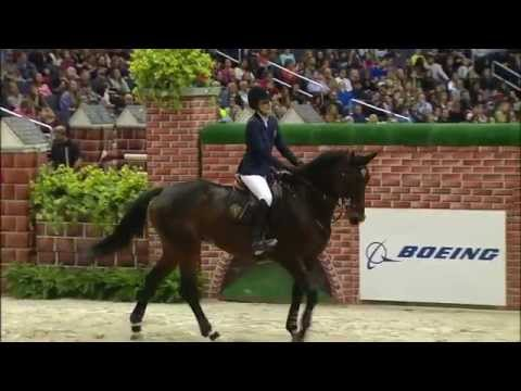 Jessica - Watch Jessica Springsteen and Lisona clear 6 feet, 10 inches (2.08 meters) to win the $25000 Puissance presented by The Boeing Company at the 2014 Washington International Horse Show.