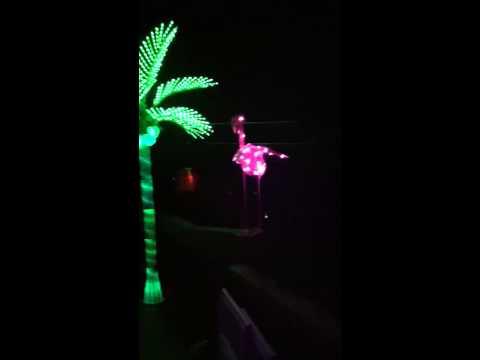 Massive led palm tree and pink flamingo