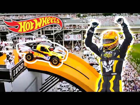 jumps - The Yellow Driver of Team Hot Wheels breaks the world record for distance jump in a four-wheeled vehicle at the Indianapolis 500 on May 29th 2011. Watch as t...