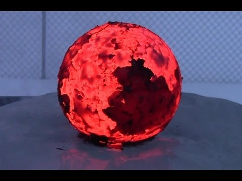 Red hot iron cannon ball dropped onto a block of ice.