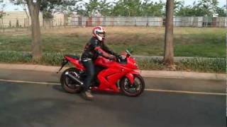 5. Sound of Kawasaki Ninja 250R 2009 (stock exhaust / muffler) with a little wheelie