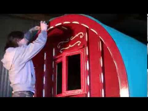 Hand painting a Wooden Horse-drawn Caravan by Fermanagh Artist Kevin McHugh Art