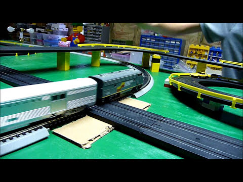HO Slot Cars versus Passenger Train on our layout - Crashes at Road & Rail crossing