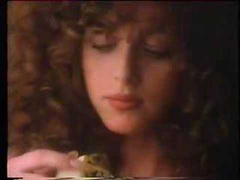 flake - Advert for the 'crumbliest, flakiest milk chocolate recorded in 1985. Gypsy girl walks through sunflower field and suggestively eats a Flake. Then she sits o...