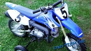 5. EZ How to access or replace the battery on a Yamaha TTR50.