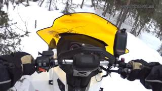 7. Skidoo Tundra 600 ACE in dense forest