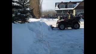 10. plowing snow with suzuki 500
