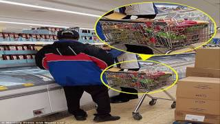 Now Domino's staff are seen piling a shopping trolley full of raw chicken wings