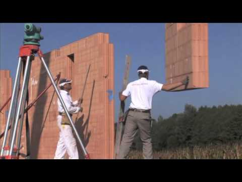 Installation of REDBLOC prefabricated wall system on a house