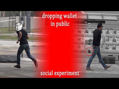 台灣街頭掉錢包!竟有黑衣男禁不住誘惑,拿起錢包拔腿就跑?!