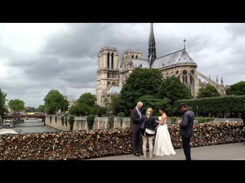 The wedding anniversary photo against a backdrop of Notre Dame Cathedral