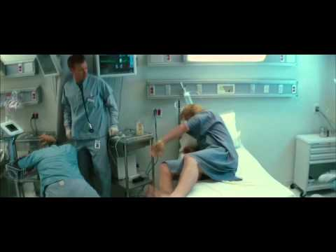 hitfixcom - Thor (Chris Hemsworth) battles a barrage of doctors and nurses whilst clad in only a gown.