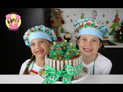 crafty - KIT-KAT CHRISTMAS CAKE with m&ms - Tutorial by Charli's crafty kitchen Sub to My Cupcake Addiction: https://www.youtube.com/user/MyCupcakeaddiction You will ...