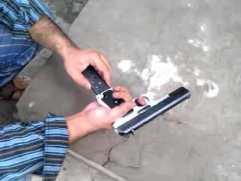 30 bore - DANISH ALI FIRRING AT ROOF WITH NORINCO WITH CHINA MODEL 30 BORE.