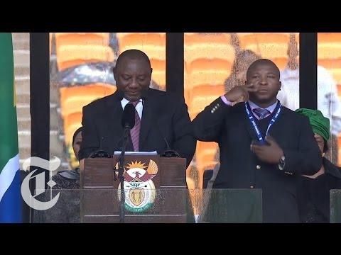 fake - Subscribe on YouTube: http://bit.ly/U8Ys7n The sign language interpreter used at the memorial service for Nelson Mandela is said to be 'fake'. Read the story...