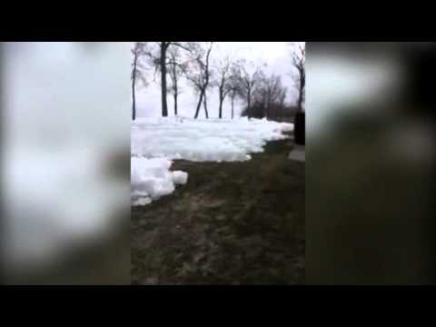 ice - Amateur video captures a wave of ice blanketing backyards and threatening houses in the Mille Lacs Lake area of Minnesota. (May 12)