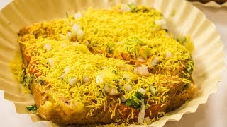 When it comes to Street Food in Hyderabad, Aloo Bread Toast stands in the top selling ones. This crispy potato smeared bread toast with garlicy-tangy-spicy and minty-coconuty chutneys along with crunchy onions, and sev is a party for the tastebuds. Let's together make this amazing aloo toast chaat for ourselves!Learn how to make more Indian Street Food: https://goo.gl/KAwq5oSubscribe to #seesomethingnew: http://goo.gl/Pw8vy7 Follow CookingShooking on Instagram @Cooking.ShookingFollow Yaman on Instagram @yaman.agBusiness Emails - business@cookingshooking.comHyderabadi Aloo Toast is on the menu today :)Ingredients: For Aloo Toast : Potatoes - 6 (boiled, peeled & grated)Salt - as per tasteTurmeric - 1/4 tspRed Chili Powder - 1/2 tspGaram Masala - 1/4 tspCoriander Powder - 1/2 tspRed Chutney - 1 tbspGreen Chutney - 1 tbspBread slices - 6-7Maida / Plain Flour - 4 tbspCorn Flour - 2 tbspSalt - 1/4 tspTurmeric - 1/8 tspOil - to deep fryFor Assembling Aloo toast: Prepared Aloo ToastRed Chutney - 6 tbspGreen Chutney - 6 tbspOnions - 12 tbspCoriander Chopped - 6 tbspNylon Sev - 12 tbspMethod:In a bowl, mix the potatoes with salt, turmeric, red chili powder, coriander powder, red & green chutney.Smear the potato mixture in one side of the bread slices. Heat up oil to deep fry. In a flat bowl, add the plain flour, corn flour, salt and turmeric. Use water as required to form a batter. Coat the potato smeared side with plain flour slurry and deep fry both sides until golden and transfer to an absorbent kitchen paper.You may choose to toast these in a tawa with 1 tsp oil.To Assemble: In a plate, place the aloo toast and smear green and red chutneys. Slice the aloo toast diagonally then sprinkle chopped onions & coriander. Finally a good layer of Nylon Sev and the Aloo Toast is ready to serve!Green Chutney : Minty Coconut ChutneyIngredients:Mint Leaves - 1 large OR 2 small bunch Coriander Leaves - 1 large OR 2 small bunchCurry Leaves - 1 sprigCoconut : 3 tbsp Salt - as per tasteLem