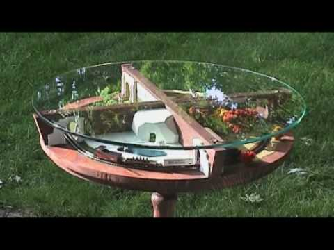 z scale model train layout - A model railway that is a train moving through sections of a zoo representing summer, fall, winter and spring. The layout is built into a glass-top side tabl...