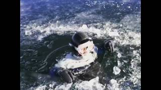 A man dressed in a diving suit jumped off a park bench and straight into a hole in a frozen lake. He swam a few yards and emerged from another hole in the ice. Check Out Our Website: http://bit.ly/DailyPicksAndFlicksSiteSubscribe For More Videos: http://bit.ly/DailyPicksAndFlicksYTLike Us On Facebook: http://bit.ly/DailyPicksAndFlicksFBFollow Us On Twitter: http://bit.ly/DailyPicksAndFlicksTWHi and welcome to Daily Picks and Flicks – viral videos, funny pictures and odd news blog. We cover all the funny, interesting and strange stuff that is buzzing around the world. The weirder the better. Each day, we surf the web in an effort to find interesting, entertaining and unique videos, pictures and weird news stories. If you like what you find here, please recommend us to your friends. We already like you.To license any of the videos shown on Daily Picks And Flicks, visit Jukin Media at http://jukinmedia.com/licensing