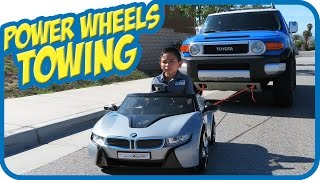 KIDS TOWING DAD's Toyota FJ Cruiser Car with Ride on Power Wheels BMW i8