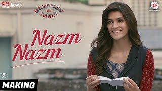 Presenting the making video of 'Nazm Nazm' from the film 'Bareilly Ki Barfi' starring Kriti Sanon and Ayushmann Khurrana.Song Name: Nazm NazmSinger: ArkoMusic: ArkoLyrics: ArkoProgramming/Music Production/Keys: Aditya Dev Guitars: Krishna Pradhan Vocals & Guitars recording: Aditya Dev Mix: Aditya Dev Master: Shadaab Rayeen  Directed By: Ashwiny Iyer TiwariProduction House: Junglee Pictures & BR Studios  Produced By: Vineet Jain, Renu Ravi ChopraCo-produced By: Priti Shahani Creative Producer: Juno ChopraWritten By: Nitesh Tiwari, Shreyas Jain Director of Photography: Gavemic U Ary Music on Zee Music CompanyDownload from iTunes - http://bit.ly/2eZEYD3Available on Google Play Music - http://bit.ly/2v9SH0jStream It OnGaana - http://bit.ly/2ub9dITSaavn - http://bit.ly/2eZlaQcWynk - http://bit.ly/2f0eAc5Set Nazm Nazm as your caller tune - SMS BKBR2 To 57575Airtel Subscribers Dial 5432116308219Vodafone Subscribers Dial 5379718396Idea Subscribers Dial 567899718396Reliance Subscribers SMS CT 9718396 to 51234BSNL (South / East) Subscribers SMS BT 9718396 to 56700BSNL (North / West) Subscribers SMS BT 6729320 to 56700Aircel Subscribers SMS DT 6729320 to 53000Connect with us on :Twitter - https://www.twitter.com/ZeeMusicCompanyFacebook - https://www.facebook.com/zeemusiccompanyYouTube - http://bit.ly/TYZMC