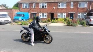 9. yamaha 2013 YZF R6 black and gold. My mate trying to ride for the 1st time funny
