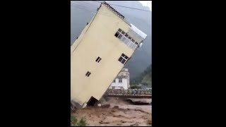 Buildings crumbling like pack of cards in flood-hit Sierra Leone. Disastrous flood hits West African country Sierra Leone. Sierra ...