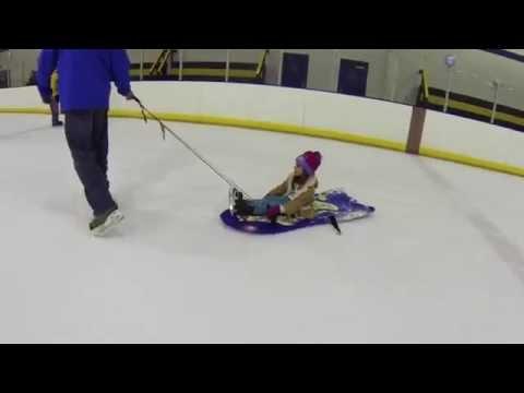 Olivia sledding at the Iceplex