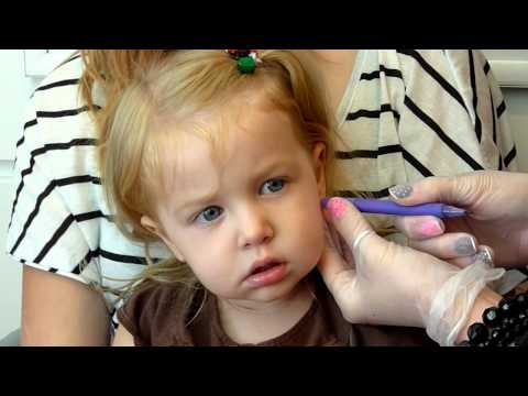 pierced - my 2 1/2 year old getting her ears pierced...and beware of the comments, its a debate about how my wife and i are terrible parents blah blah blah...use my vi...