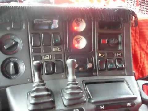 Scania 113 subindo serra carregado