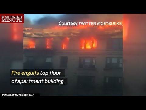 A raging fire burned through an apartment building in upper Manhattan on Friday