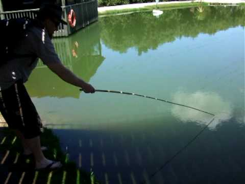 Uncle Slade fishing for prawns – Huka prawn farm, Taupo