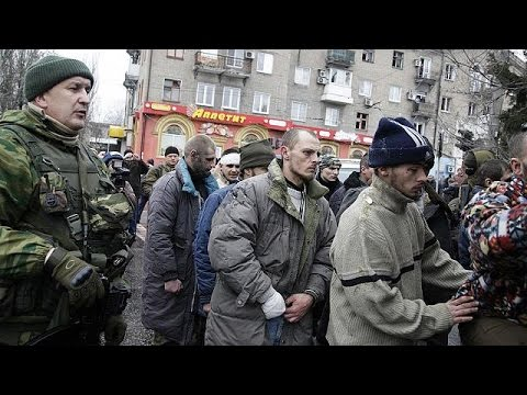 crowd - Captured Ukrainian servicemen have been taken to the scene of Thursday's deadly bus stop attack in Donetsk and paraded before an angry crowd, firmly convinced that Kyiv was behind the bloodshed.