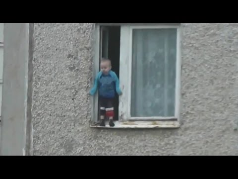 Video Nothing to see here: Toddler hangs from 8th floor window in Russia download in MP3, 3GP, MP4, WEBM, AVI, FLV January 2017
