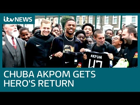 Ex-Arsenal Striker Chuba Akpom Returns To Old London School A Greek Hero | ITV News