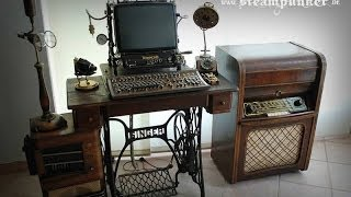 www.steampunker.dewww.facebook.de/steampunkArtworkSteampunk workstation consisting of a computer table, a computer, a monitor, a modified IBM model M - keyboard and a wireless mouse. The table was build from an old Singer sewing machine. The wood was completely reapplied (the patina retained). Three compartments provide storage space for small items. The PC was installed in an old wooden radio cabinet.