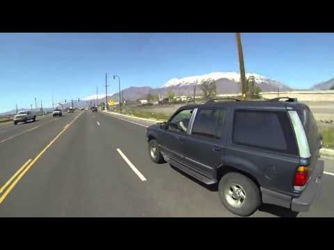 Motorcyclist Grabs Coffee Mug From Back Bumper Of Passing SUV