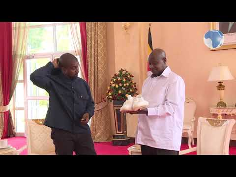 Musician Kanye West gifts Uganda's Museveni a pair of white sneakers