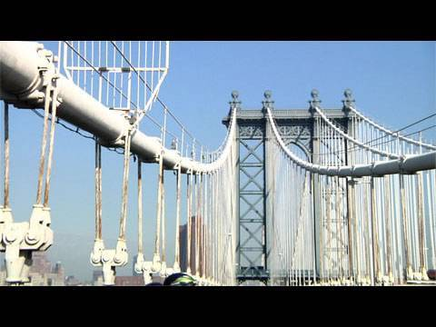 Manhattan Bridge - Rocketboom field correspondent Ella Morton heads down to the Manhattan Bridge Centennial Parade to learn more about the bridge's rich history. Follow Rocketb...