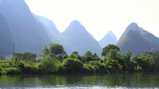 Bamboo rafting along the YuLong River 遇龙河 ...