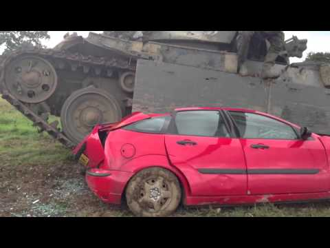 Military tank crushes Ford Focus