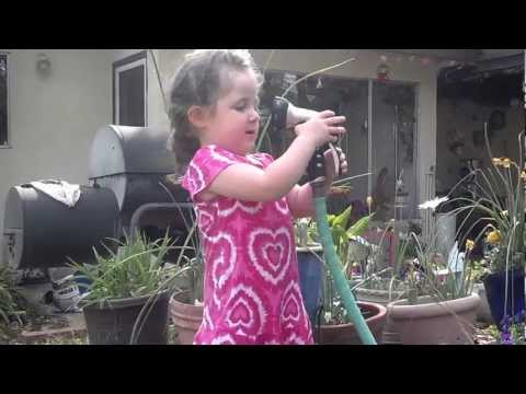 Little girl learns about water pressure with her grandmother