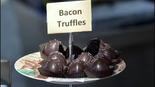 Linda and Billy Douglas, of CS Chocolates and Sweets describe their bacon truffles, which they were selling at the Hilton Head Wine & Food Festival's Public Tasting event on March 11, 2017 at Harbour Town.