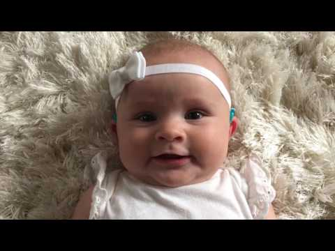 Baby puts on hearing aids for the first time